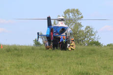"<div class=""source"">JOHN SINGLETON/The Kentucky Standard</div><div class=""image-desc"">One patient was airlifted to a hospital after he was seriously injured in a head-on collision Monday afternoon on Balltown Road.</div><div class=""buy-pic""></div>"