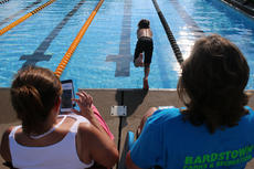 "<div class=""source"">PETER W. ZUBATY/The Kentucky Standard</div><div class=""image-desc"">Timekeepers monitor the action at a recent Bardstown Barracudas youth swim meet, using the Meet Central app on their phones for real-time instant results. The app was developed by Olympic gold medalist Charlie Houchin and is being used by several youth swim leagues, including the Kentuckiana Swim Association, in which the Bardstown Barracudas compete.</div><div class=""buy-pic""></div>"