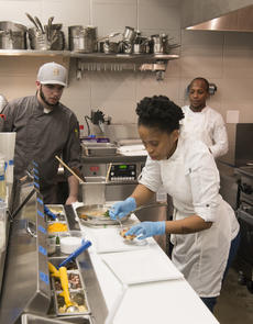 """<div class=""""source"""">PETER W. ZUBATY/The Kentucky Standard</div><div class=""""image-desc"""">Abaleng """"Abi"""" Moragoshele prepares a plate of sweet potato gnocchi in the kitchen at the Bardstown Bourbon Company, while watched by Jared Field left, and Lehlohonolo """"Iggy"""" Matlala. The students in the one-year culinary internship at the distillery's restaurant hail from South Africa, India and The Phillipines.</div><div class=""""buy-pic""""><a href=""""/photo_select/96124"""">Buy this photo</a></div>"""