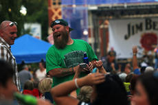 """<div class=""""source"""">KACIE GOODE/The Kentucky Standard </div><div class=""""image-desc"""">Concert-goers laugh and socialize Saturday during the 2016 Bourbon City Street Concert. </div><div class=""""buy-pic""""><a href=""""/photo_select/77651"""">Buy this photo</a></div>"""