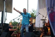 """<div class=""""source"""">KACIE GOODE/The Kentucky Standard </div><div class=""""image-desc"""">Emcee Matthew Fogle of PLG TV-13 works on keeping the crowd entertained as acts switch out during the 2016 Bourbon City Street Concert July 9. </div><div class=""""buy-pic""""><a href=""""/photo_select/77656"""">Buy this photo</a></div>"""