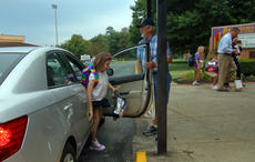 "<div class=""source"">KACIE GOODE/The Kentucky Standard</div><div class=""image-desc"">""Papa Joe"" Nalley opens car doors and greets kids on the first day of school Tuesday at Bardstown Elementary. The volunteer has been helping out for the past four years.</div><div class=""buy-pic""><a href=""/photo_select/88062"">Buy this photo</a></div>"