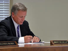 """<div class=""""source"""">KACIE GOODE/The Kentucky Standard</div><div class=""""image-desc"""">Superintendent Brent Holsclaw goes over some documents Tuesday night prior to the approval of a preliminary 4 percent increase in revenue during a tax discussion. A public hearing is scheduled for Aug. 14, with final decision to be made Aug. 15.</div><div class=""""buy-pic""""><a href=""""/photo_select/88162"""">Buy this photo</a></div>"""
