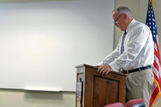 """<div class=""""source"""">KACIE GOODE/The Kentucky Standard</div><div class=""""image-desc"""">Director of Human Resources and Technology Joey Downs talks about SEEK funding during a special-called meeting Tuesday night, at which Bardstown Independent School Board approved a preliminary 4 percent increase in revenue. A Tax Hearing is set for Aug. 14 at 6 p.m.</div><div class=""""buy-pic""""><a href=""""/photo_select/88163"""">Buy this photo</a></div>"""