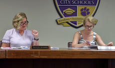 """<div class=""""source"""">KACIE GOODE/The Kentucky Standard</div><div class=""""image-desc"""">Tracey Rogers explains assessments Tuesday night prior to the Bardstown Independent School Board approving a preliminary 4 percent increase in revenue during a tax discussion. A public hearing is scheduled for Aug. 14, with final decision to be made Aug. 15.</div><div class=""""buy-pic""""><a href=""""/photo_select/88164"""">Buy this photo</a></div>"""