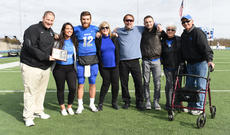 "<div class=""source"">COURTESY OF LINDSEY WILSON ATHLETICS</div><div class=""image-desc"">Dylan Beasley (12), a Bloomfield native and record-setter at Nelson County High School, poses with family members following a game at Lindsey Wilson College in the fall. Beasley and his fiancé, Mariah Stearns (second from left), also a Nelson County native, will be heading overseas to Bergen, Norway, to play in that country's American football league in March.</div><div class=""buy-pic""></div>"
