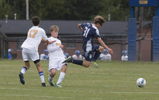 """<div class=""""source"""">PETER W. ZUBATY/The Kentucky Standard</div><div class=""""image-desc"""">Thomas Nelson's Donovan Roswell hurdles Bethlehem's Blake Vittitow while chasing down a ball during the Generals' 3-2 shootout win Monday.</div><div class=""""buy-pic""""></div>"""