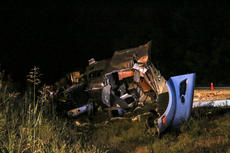 """<div class=""""source"""">KACIE GOODE/The Kentucky Standard</div><div class=""""image-desc"""">A mangled mound is all that is left of a semi-tanker that overturned in the median Tuesday night on the Bluegrass Parkway. The Nelson County Sheriff's Office and firefighters worked the scene of the injury accident  near the 22-mile marker westbound. The driver, 49-year-old Franklin Lawrence of Hurricane, West. Va., was transported to Flaget Memorial Hospital and later flown to University of Louisville Hospital with serious injuries. The liquid carried in Lawrence's tanker was determined to be nonflammable, but the roadway was closed for more than 12 hours as crews worked to clean the scene.</div><div class=""""buy-pic""""><a href=""""/photo_select/69480"""">Buy this photo</a></div>"""
