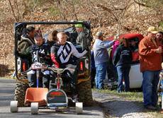 "<div class=""source"">KACIE GOODE/The Kentucky Standard</div><div class=""image-desc"">Participants catch a ride up the hill Sunday during the Cissal Hill Big Wheel Race in New Haven.</div><div class=""buy-pic""><a href=""/photo_select/91235"">Buy this photo</a></div>"