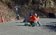 "<div class=""source"">KACIE GOODE/The Kentucky Standard</div><div class=""image-desc"">A curve on Cissal Hill Road resulted in several back-to-back crashes during Sunday's Big Wheel Race, which is exactly what the crowds were waiting to see.</div><div class=""buy-pic""><a href=""/photo_select/91236"">Buy this photo</a></div>"