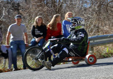 "<div class=""source"">KACIE GOODE/The Kentucky Standard</div><div class=""image-desc"">A racer flies around a curve on Cissal Hill Road Sunday afternoon while taking part in the annual Big Wheel Race.</div><div class=""buy-pic""><a href=""/photo_select/91238"">Buy this photo</a></div>"