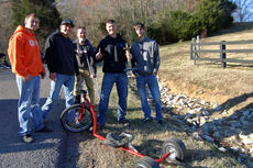"<div class=""source"">KACIE GOODE/The Kentucky Standard</div><div class=""image-desc"">Kurt Edelen, second from right, poses for a photo Sunday afternoon with friends and organizers Levi Wooldridge and Jason Newton after winning the Cissal Hill Big Wheel Race for the fifth time.</div><div class=""buy-pic""><a href=""/photo_select/91247"">Buy this photo</a></div>"