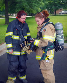 """<div class=""""source"""">HANNAH BOWMAN/City of Bardstown</div><div class=""""image-desc"""">Jill Mattingly, right, daughter of Bardstown Fire Chief Billy Mattingly and one of the city's first female volunteer firefighters in several years, shows Katilyn Birge of the Nichols Fire Department who a gauge works on an air pack. Mattingly also is a volunteer for Nichols, in Bullitt County.</div><div class=""""buy-pic""""></div>"""