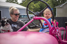 "<div class=""source"">KACIE GOODE/The Kentucky Standard</div><div class=""image-desc"">Saylor Dudgeon on pink tractor </div><div class=""buy-pic""><a href=""/photo_select/103746"">Buy this photo</a></div>"
