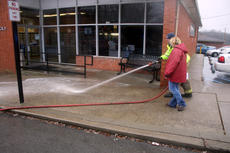 """<div class=""""source"""">TREY CRUMBIE/The Kentucky Standard</div><div class=""""image-desc"""">Scott Thompson, captain of Northeast Nelson Fire Protection District, and Bobbie Baker work together to clean the front of the Bloomfield Post Office Tuesday morning. The Nelson County Sheriff's Office investigated a homicide on Taylorsville Road in which one man was killed.</div><div class=""""buy-pic""""><a href=""""/photo_select/71580"""">Buy this photo</a></div>"""