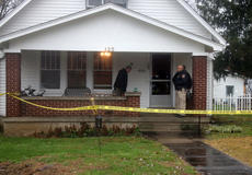 """<div class=""""source"""">TREY CRUMBIE/The Kentucky Standard</div><div class=""""image-desc"""">Officials from the Nelson County Sheriff's Office stand outside a taped off home on Taylorsville Road in Bloomfield Tuesday morning following a shooting death. One man is dead and at least two people were taken in custody.</div><div class=""""buy-pic""""><a href=""""/photo_select/71578"""">Buy this photo</a></div>"""