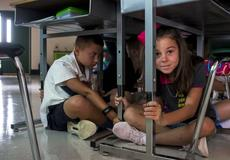 "<div class=""source"">KACIE GOODE/The Kentucky Standard</div><div class=""image-desc"">Madison York practices an earthquake drill with classmates as Boston fourth- and fifth-graders go over emergency procedures on the first day of school for Nelson County.</div><div class=""buy-pic""><a href=""/photo_select/97323"">Buy this photo</a></div>"