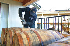 """<div class=""""source"""">KACIE GOODE/The Kentucky Standard</div><div class=""""image-desc"""">Barrels are sealed Monday as they make their way to waiting trucks, vans and cars for transport. Dozens of Kentucky craft brewers picked up barrels from Willett Distillery to use for a brewing experiment.</div><div class=""""buy-pic""""><a href=""""/photo_select/91567"""">Buy this photo</a></div>"""