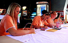 """<div class=""""source"""">Stephanie Hornback/The Kentucky Standard</div><div class=""""image-desc"""">Big Brothers Big Sisters of Kentuckiana staff members keep count of the scores. Left to right are Emily Reder, Courtney Payne, Christina Clements and Terri Taylor.</div><div class=""""buy-pic""""><a href=""""/photo_select/25260"""">Buy this photo</a></div>"""