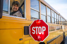 """<div class=""""source"""">KACIE GOODE/The Kentucky Standard</div><div class=""""image-desc"""">Bus driver Kelly Kidd smiles from his seat while displaying his bus' stop sign.</div><div class=""""buy-pic""""><a href=""""/photo_select/101561"""">Buy this photo</a></div>"""