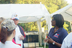 "<div class=""source"">TREY CRUMBIE/The Kentucky Standard</div><div class=""image-desc"">Jenean Hampton, running mate of Republican gubernatorial candidate Matt Bevin, speaks with supporters at the Buttermilk Breakfast Saturday morning. This was the first time the Detroit native attended Buttermilk Days.</div><div class=""buy-pic""><a href=""/photo_select/68868"">Buy this photo</a></div>"