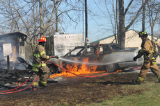 """<div class=""""source"""">RANDY PATRICK/The Kentucky Standard</div><div class=""""image-desc"""">Firefighters battle the blaze after an old Cadillac bursts into flames after the outbuilding near it burned to the ground. A woman who lived at 5885 Louisville Road, was badly burned in the first blaze.</div><div class=""""buy-pic""""><a href=""""/photo_select/93505"""">Buy this photo</a></div>"""