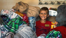 "<div class=""source"">File Photo/The Kentucky Standard</div><div class=""image-desc"">Last year, Cambron Blair worked hard to create winter kits for the homeless in Nelson County and Louisville. This year, after being diagnosed with a rare medical condition, the local 10-year-old is shifting his focus to helping cheer up hospitilized children.</div><div class=""buy-pic""></div>"