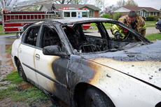 """<div class=""""source"""">KACIE GOODE/The Kentucky Standard</div><div class=""""image-desc"""">Police and Bardstown firefighters responded to the report of a vehicle fire fully involved shortly before 4:30 p.m. on Wednesday. The incident occurred in front of a home in the 100 block of Fern Lea Circle. </div><div class=""""buy-pic""""><a href=""""/photo_select/75001"""">Buy this photo</a></div>"""