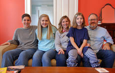 """<div class=""""source"""">KACIE GOODE/The Kentucky Standard</div><div class=""""image-desc"""">Caroline Carwile sits with her family in their Bloomfield home. Caroline, 11, has Nager syndrome, a very rare condition. Pictured are, from left, brother Parker, sister Vivian, mom Sandy, Caroline, and dad Richard. Not pictured is sister Anna Claire, 13.</div><div class=""""buy-pic""""><a href=""""/photo_select/91357"""">Buy this photo</a></div>"""