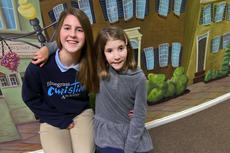 """<div class=""""source"""">KACIE GOODE/The Kentucky Standard</div><div class=""""image-desc"""">Anna Claire Carwile poses for a photo with little sister Caroline. They both attend Bluegrass Christian Academy in Bardstown. As the book and film """"Wonder"""" have brought attention to craniofacial conditions and various syndromes across America, Caroline's family is thankful to have experienced kindness in love after she was born with Nager Syndrome.</div><div class=""""buy-pic""""><a href=""""/photo_select/91358"""">Buy this photo</a></div>"""