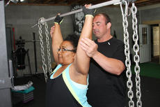"<div class=""source"">PETER W. ZUBATY/The Kentucky Standard</div><div class=""image-desc"">K.O. instructs Carrie Pride on the proper way to do an overhead press with chains weighing 30 pounds at Darkside Athletics.</div><div class=""buy-pic""><a href=""/photo_select/55764"">Buy this photo</a></div>"