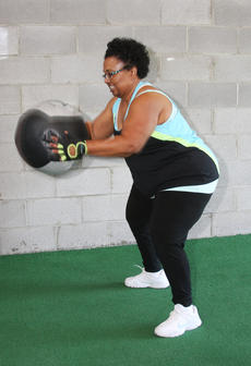 "<div class=""source""></div><div class=""image-desc"">Carrie Pride sweats it out with medicine ball slams at a morning training session at Darkside Athletics.</div><div class=""buy-pic""><a href=""/photo_select/55775"">Buy this photo</a></div>"