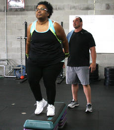 "<div class=""source"">PETER W. ZUBATY/The Kentucky Standard</div><div class=""image-desc"">K.O. gives support as Carrie Pride does a lateral jump over at her morning training session at Darkside Athletics.</div><div class=""buy-pic""><a href=""/photo_select/55765"">Buy this photo</a></div>"