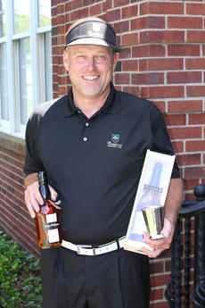 "<div class=""source"">DENNIS GEORGE/Contributing Photographer</div><div class=""image-desc"">Chad Riggs shows off his hardware after winning the 69th Bourbon Open Golf Tournament. Riggs fired a 1-under par 70 to claim the title in his 27th try.</div><div class=""buy-pic""><a href=""/photo_select/56312"">Buy this photo</a></div>"