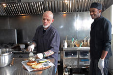 """<div class=""""source"""">RANDY PATRICK/The Kentucky Standard</div><div class=""""image-desc"""">Charlie Thornton takes a Shroom & Swiss burger off the grill at Rylon Sweeney's Wednesday. The burgers are 75 percent Angus, 25 percent lamb and are served on oatmeal-dusted buns.</div><div class=""""buy-pic""""><a href=""""/photo_select/93740"""">Buy this photo</a></div>"""