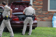 "<div class=""source""></div><div class=""image-desc"">Nelson County sheriff's deputies search a car involved in a vehicle pursuit. During the pursuit, Fogle lost control of his vehicle and wrecked in a yard on Engleman St. Fogle tried to escape on foot, but was quickly caught by a police K9 unit.</div><div class=""buy-pic""><a href=""/photo_select/95766"">Buy this photo</a></div>"