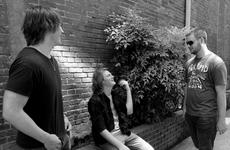 """<div class=""""source"""">Photo by Larissa Heck</div><div class=""""image-desc"""">Members of Cherrywood Drive, a new, multi-genre band in Bardstown, chat in an alley off Third Street. The three Bardstown Seniors are lined up to play for the Bourbon Festival this year.</div><div class=""""buy-pic""""></div>"""