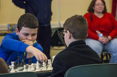 """<div class=""""source"""">KACIE GOODE/The Kentucky Standard</div><div class=""""image-desc"""">Ethan Ballard calculates a move against his opponent Saturday during the Bardstown Optimist Club's fifth annual chess tournament.</div><div class=""""buy-pic""""><a href=""""/photo_select/83106"""">Buy this photo</a></div>"""