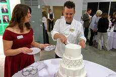 "<div class=""source"">KACIE GOODE/The Kentucky Standard</div><div class=""image-desc"">New Life Center board member Marie Washburn holds the plates while Fred Moore cuts the cake Saturday during the Chocolate Extravaganza.</div><div class=""buy-pic""><a href=""/photo_select/93333"">Buy this photo</a></div>"