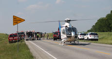 """<div class=""""source"""">RANDY PATRICK/The Kentucky Standard</div><div class=""""image-desc"""">A helicopter waits to fly an injured driver to University of Louisville Hospital late Monday afternoon following a head-on collision on US 31E north of Cox's Creek that injured three people.</div><div class=""""buy-pic""""><a href=""""/photo_select/95244"""">Buy this photo</a></div>"""