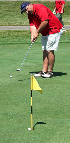 """<div class=""""source"""">DENNIS GEORGE/Contributing Photographer</div><div class=""""image-desc"""">Another one in the hole. Chuck Filiatreau makes another putt while practicing before last Friday&#039;s Flaget Hospital scramble at Maywood.</div><div class=""""buy-pic""""></div>"""
