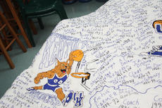 """<div class=""""source"""">Peter W. Zubaty</div><div class=""""image-desc"""">Darleene Wimsett's Kentucky Wildcats quilt features hand-embroidered names and dates for all former players and coaches, as well as several autographs and numerous hand-stitched graphics across its 9x9-foot surface.</div><div class=""""buy-pic""""><a href=""""/photo_select/36582"""">Buy this photo</a></div>"""