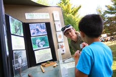 """<div class=""""source"""">KACIE GOODE/The Kentucky Standard</div><div class=""""image-desc"""">Nathan Raymer, 6, shares his knowledge of wildlife with Tammy Reed, a volunteer naturalist assistant, at one of the discovery stations at Bernheim's ColorFest.</div><div class=""""buy-pic""""><a href=""""/photo_select/80425"""">Buy this photo</a></div>"""