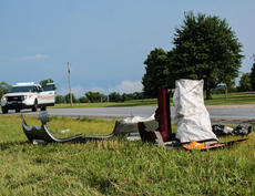 """<div class=""""source"""">KACIE GOODE/The Kentucky Standard</div><div class=""""image-desc"""">Remnants of a car sit just off the roadway Monday evening following a three-vehicle crash  on New Shepherdsville Road which sent three to the hospital.</div><div class=""""buy-pic""""><a href=""""/photo_select/67557"""">Buy this photo</a></div>"""