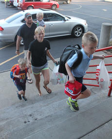 "<div class=""source"">RANDY PATRICK/The Kentucky Standard</div><div class=""image-desc"">Coen Culver bounds up the steps at St. Joe Elementary on the first day of school with his family several steps behind. They are his parents, Kyle and Keri, younger brother Carson and baby brother C.J.</div><div class=""buy-pic""><a href=""/photo_select/88149"">Buy this photo</a></div>"