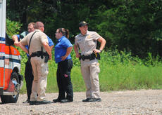 """<div class=""""source"""">RANDY PATRICK/The Kentucky Standard</div><div class=""""image-desc"""">Deputy Sheriff Jarren Culver scans the area around Culvertown Community Park while Deputy Josh Greenwell talks to emergency medical personnel following a report of a shooting incident Tuesday afternoon. An arrest was made Wednesday.</div><div class=""""buy-pic""""><a href=""""/photo_select/97308"""">Buy this photo</a></div>"""