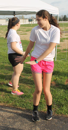 """<div class=""""source"""">RANDY PATRICK/The Kentucky Standard</div><div class=""""image-desc"""">Nelson County High School student Amber Keene dances while waiting for the Reagan Carter 5K Color Run to begin Saturday morning at Dean Watts Park.</div><div class=""""buy-pic""""><a href=""""/photo_select/94528"""">Buy this photo</a></div>"""