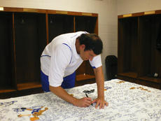 """<div class=""""source"""">DARLEENE WIMSETT/Special To The Standard</div><div class=""""image-desc"""">Scott Padgett is one of 11 people whose signatures Darleene Wimsett has collected on her one-of-a-kind quilt honoring the history of University of Kentucky men's basketball. Wimsett said Padgett is her all-time favorite Wildcat.</div><div class=""""buy-pic""""></div>"""