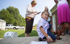 "<div class=""source"">FORREST BERKSHIRE/The Kentucky Standard</div><div class=""image-desc"">Erick Cortez's 3-year-old son, Oliver, plays with a dinosaur in the family's back yard while his wife and mother-in-law work the phones trying to find someone to help with his deportation case. Cortez was taken into custody June 22 and returned to Mexico July 26. Oliver thinks his dad is hunting dinosaurs, but in reality he might be barred from the country for at least 10 years.</div><div class=""buy-pic""><a href=""/photo_select/88252"">Buy this photo</a></div>"