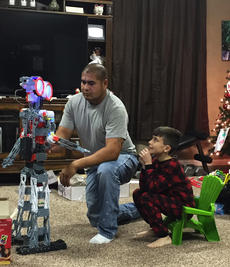 "<div class=""source"">PHOTO SUBMITTED</div><div class=""image-desc"">erick Cortez helps construct a Christmas present for the son of his wife, Ashley Rogers. Rogers and Cortez have two children together, but with Cortez deported late last month to Mexico, he might not be able to return to them for 10 years or more.</div><div class=""buy-pic""><a href=""/photo_select/88254"">Buy this photo</a></div>"